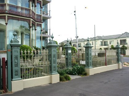 cast iron fence with decorative posts