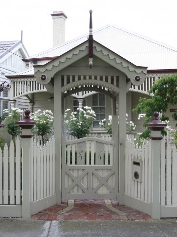 white picket fence with fancy feature gate