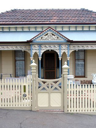 Victoria style timber picket feature gate with cast iron verandah