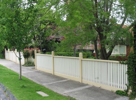 white and yellow fence
