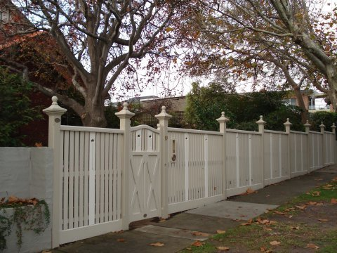 white fence and cast iron capitals