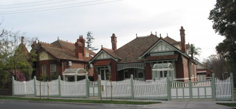 victorian house with picket fencing