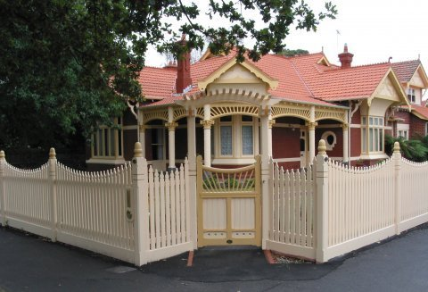 cream painted picket fence