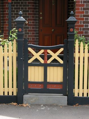cast iron capitals painted on gate