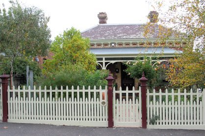 fence around traditional house