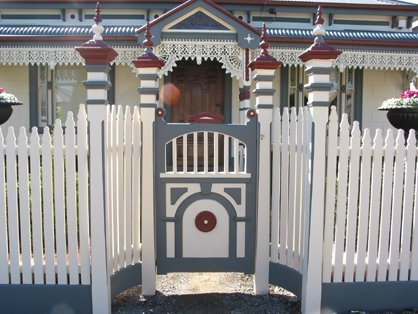 white picket fence and detailed gate