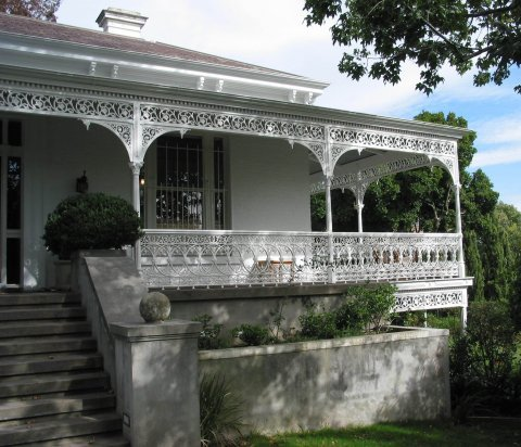 detailed cast iron fencing around verandah of house