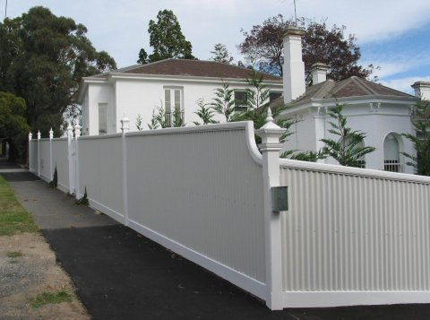brand new white fence made by perry bird pickets