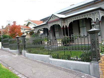 Cast iron fence on concrete base and cast iron verandah by Perry Bird Pickets