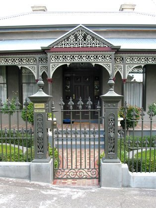 verah with cast iron detail behind cast iron fence and gate