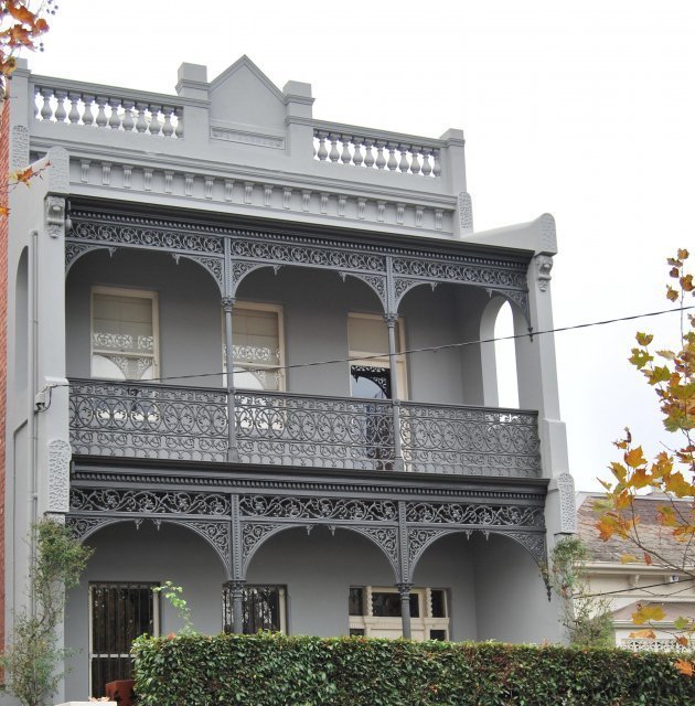 cast iron verandah on grey painted victorian style home