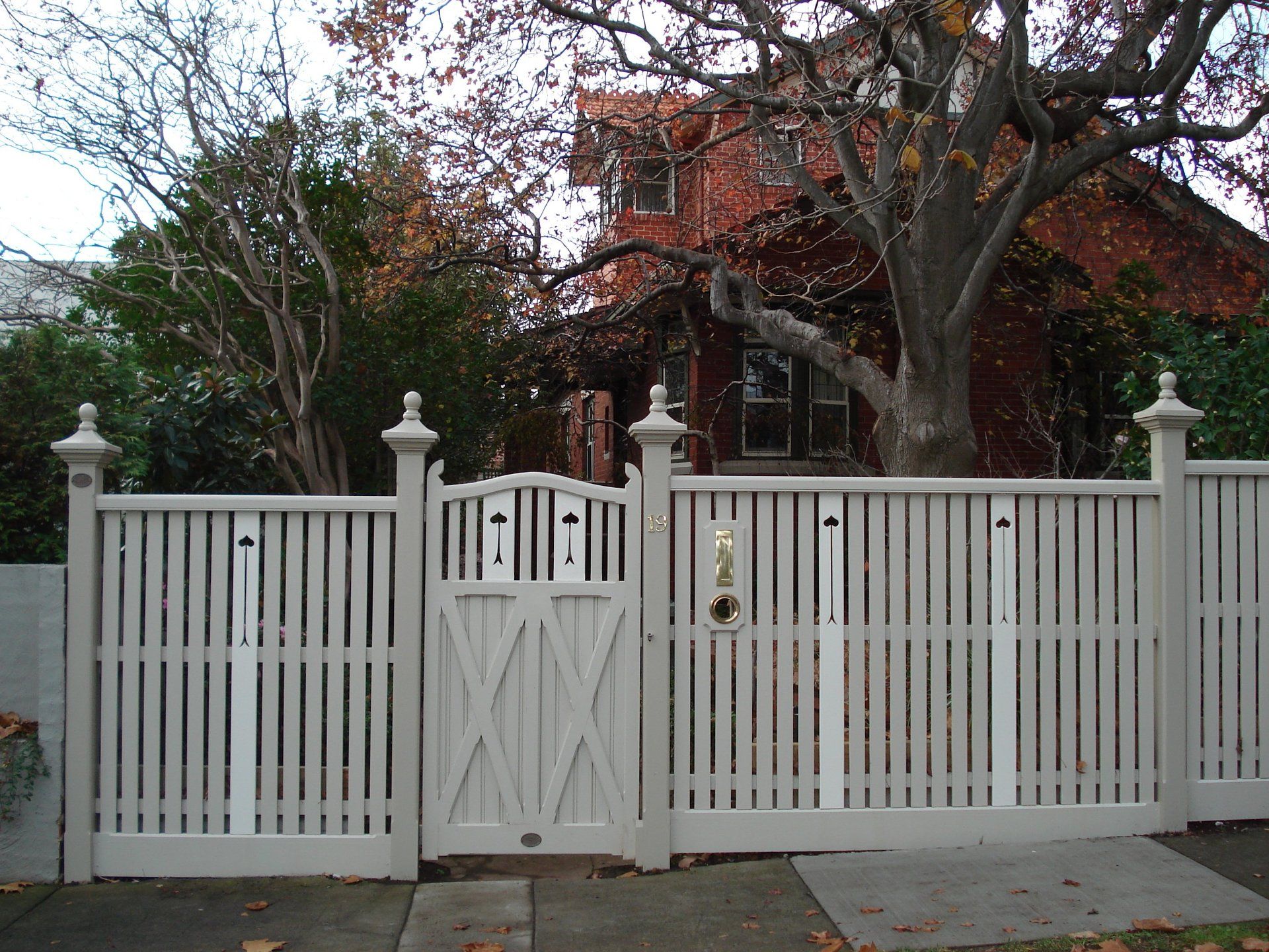Timber picket feature gate with motif and fence by Perry Bird Pickets