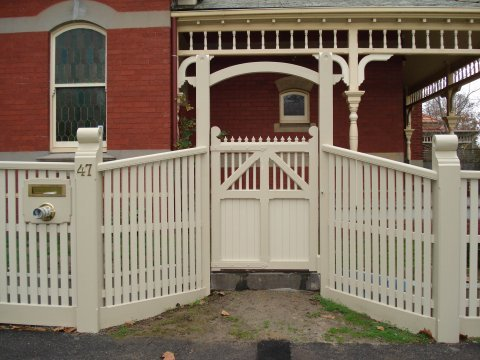 fence work and gate designed by perry bird pickets