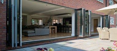 Bi-fold doors between a living room and patio