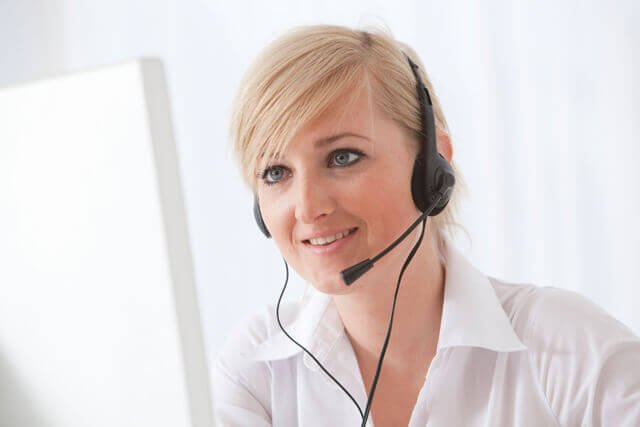 A woman with a telephone headset