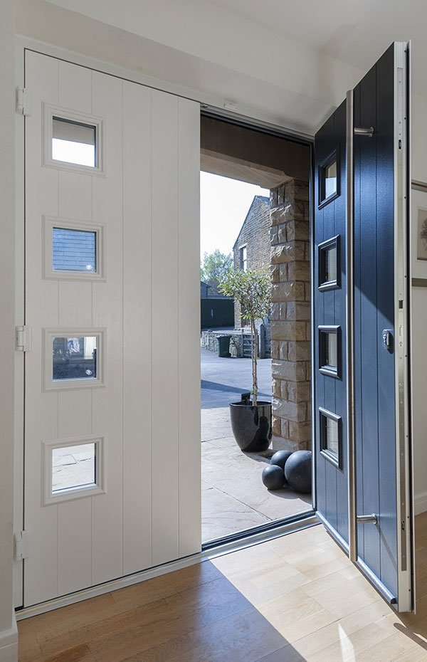 A composite door with matching side panel and windows