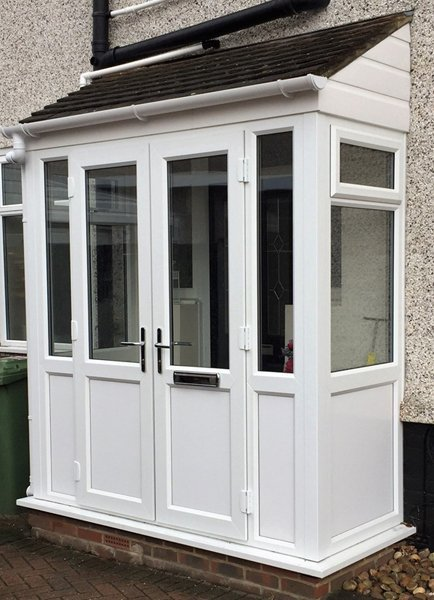 A porch with uPVC front door and matching side panel