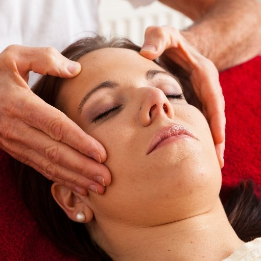 A woman having her temples massaged