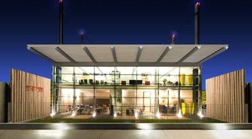 Un edificio in vetro con una tettoia con le luci accese