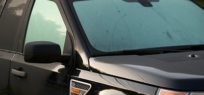 Advanced Window Tinting tinted window of car