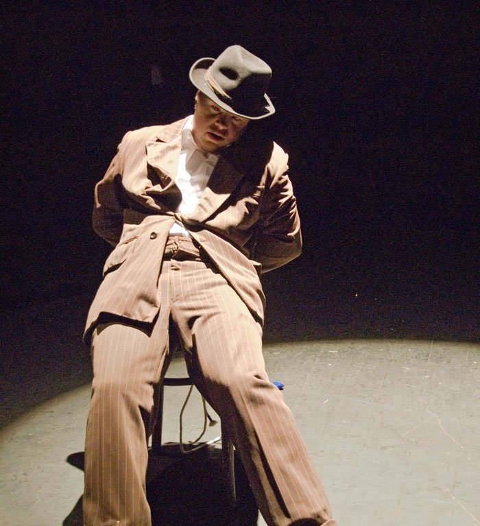 man playing in a theatre play