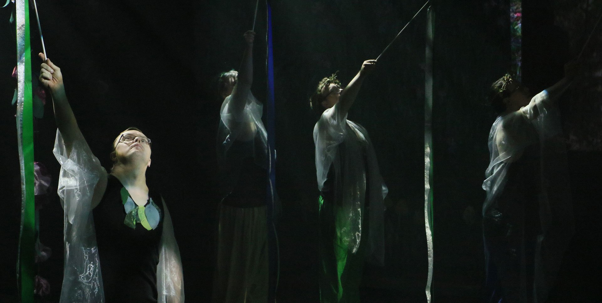 girls performing on a dark stage