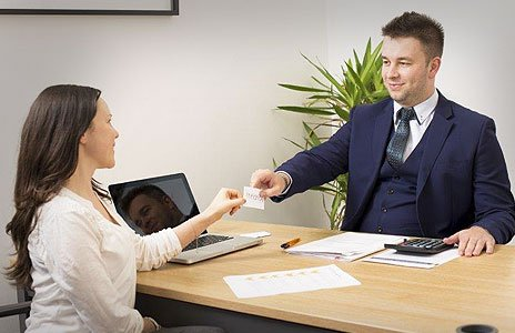 couple with investment adviser