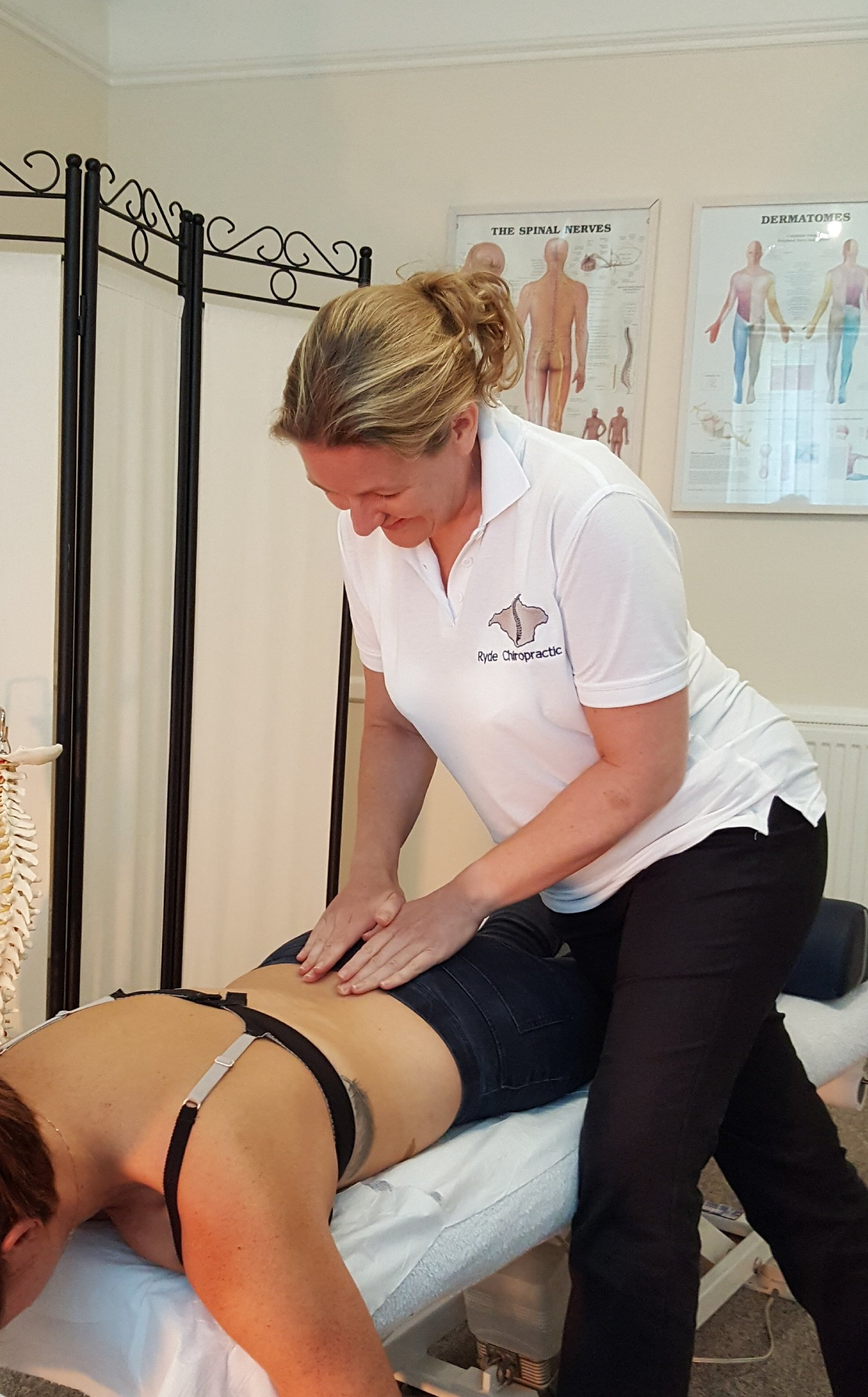 A woman receiving a shoulder treatment