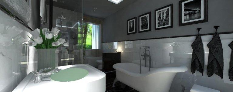 un bagno arredato in colori bianco e nero