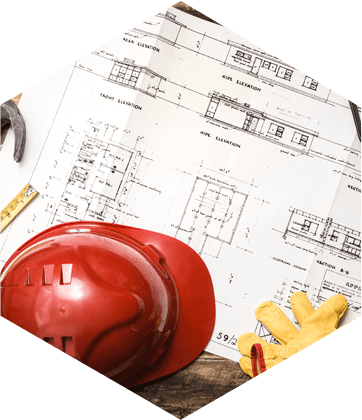 Building plans and red hard hat