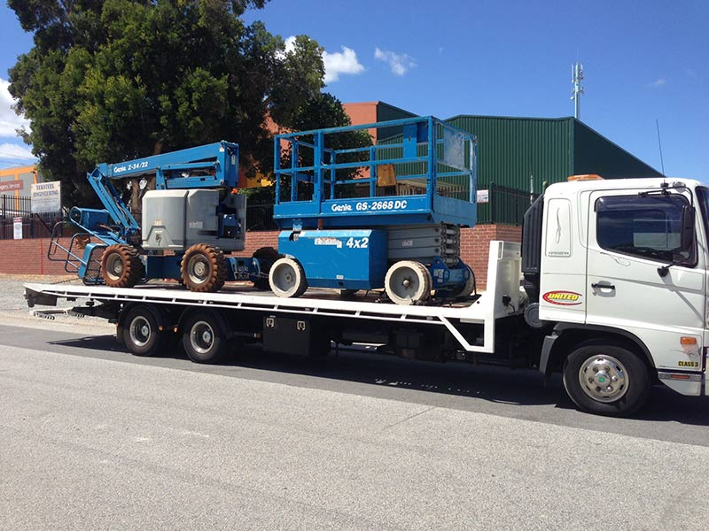 common machinery on a flatbed truck