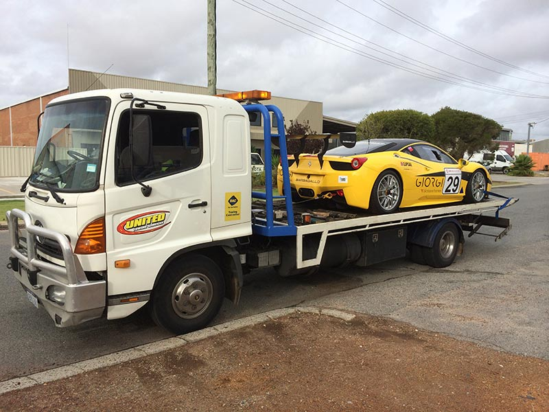 yellow racing car on our truck