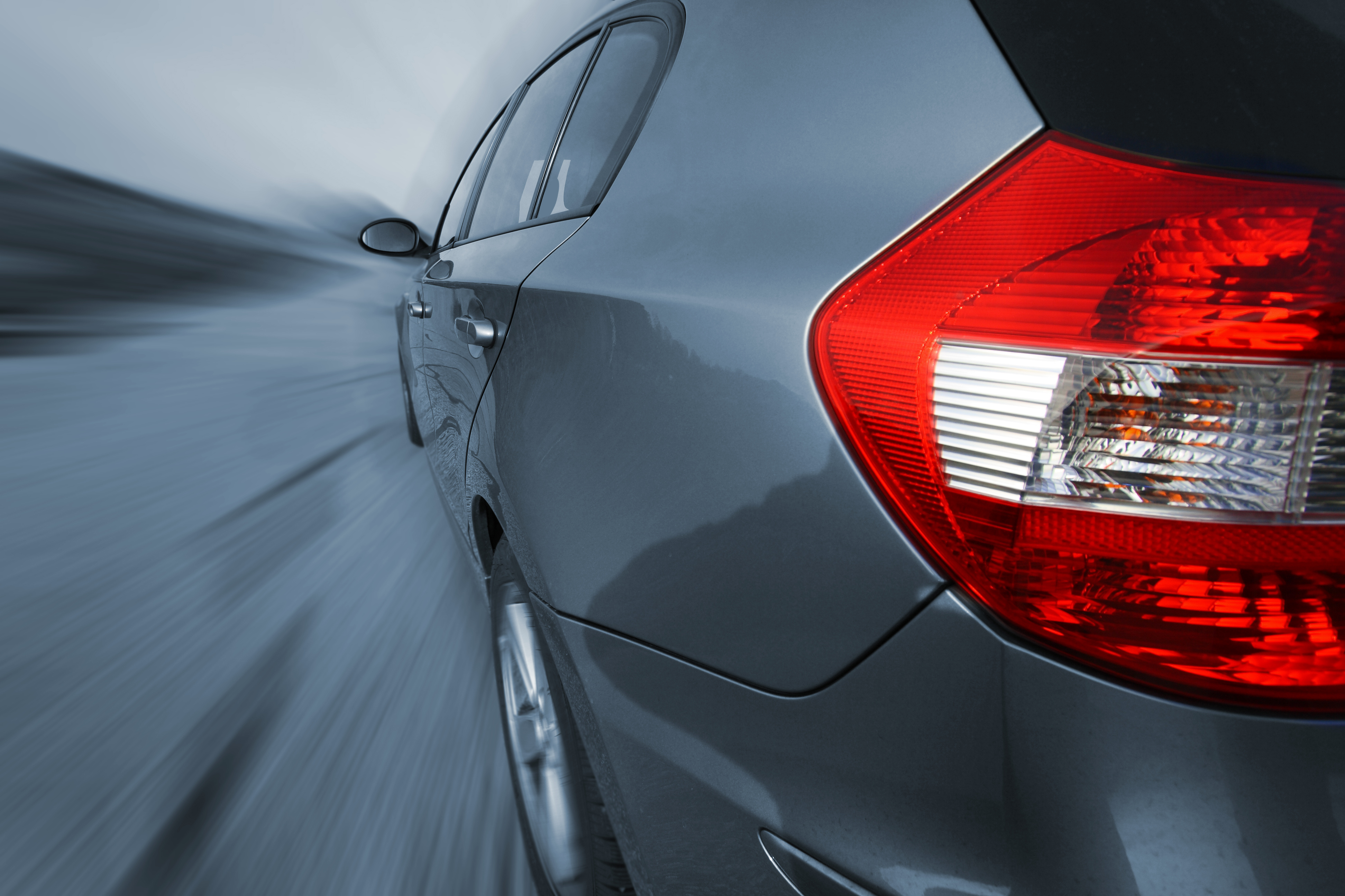 close up of a tail light on a luxury car