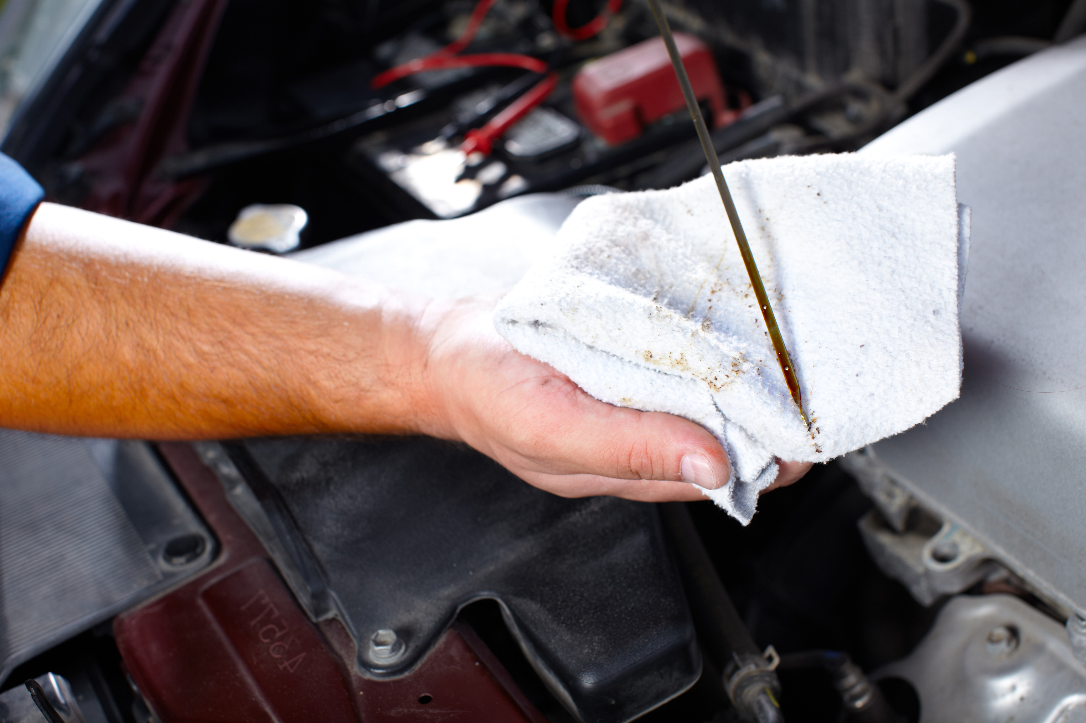 close up of mechanic performing an oil change
