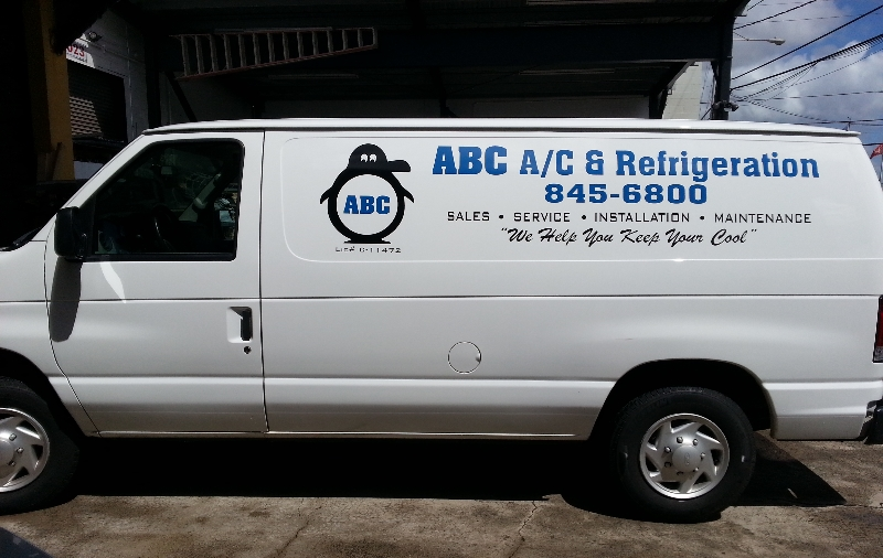 An ABC A/C & Refrigeration van at a residence