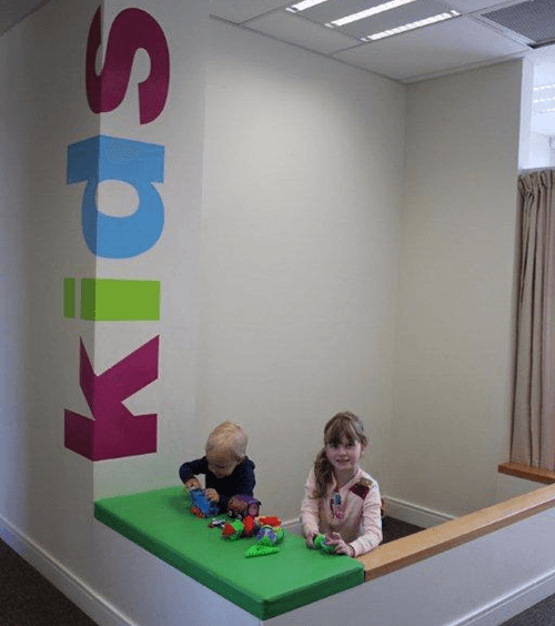 Kids playing at the kids desk in Collingwood Health clinic