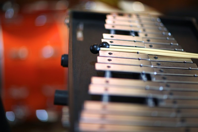 Closeup of a xylophone with percussion sticks