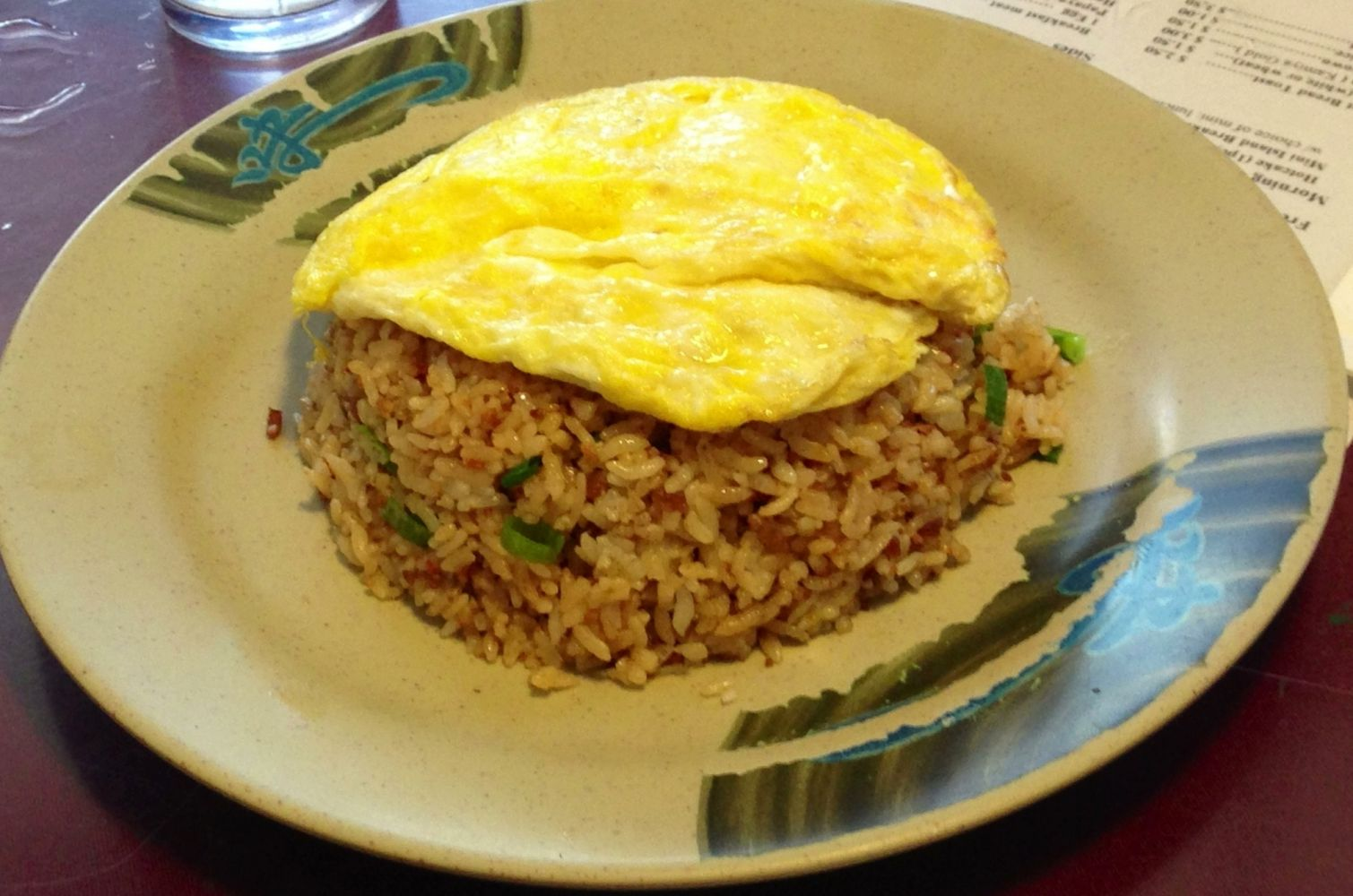 One of our traditional dishes, Ono fried rice topped with egg at Asahi Grill Ward in Honolulu, Hawaii