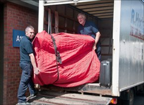Home removals - Workington, Cumbria - Raymond Hodgson Removals - Carrying sofa