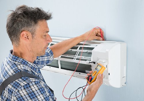 technician testing air conditioning