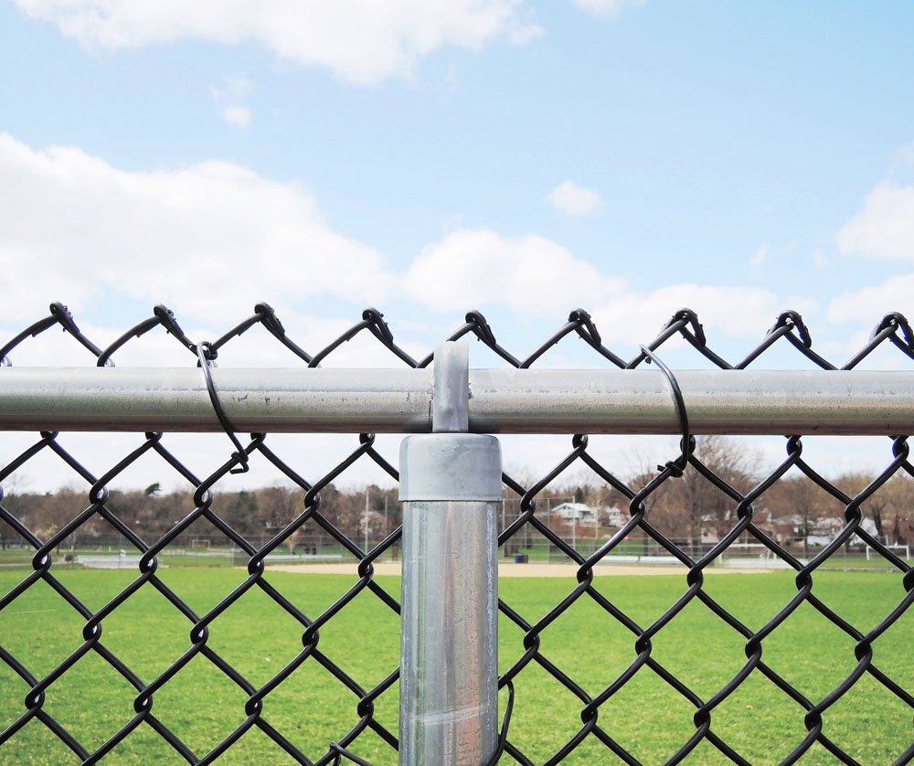 A sports field with a chain link fence