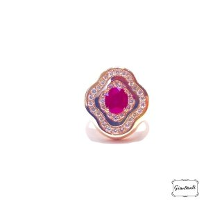 Anello in oro rosa, diamanti e rubino