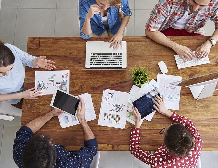Team of professionals building local retail strategies