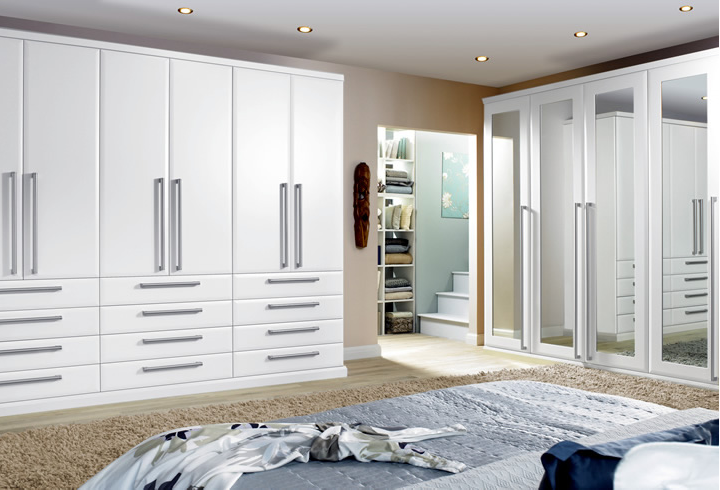 bedroom fitting with wardrobes