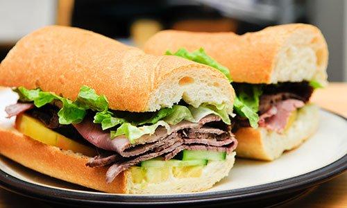 Roast beef sliced on a submarine roll