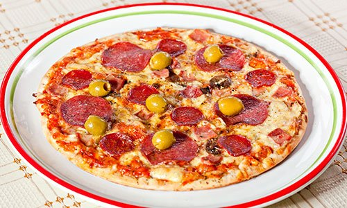 Bacon and pepperoni pizza with green olives
