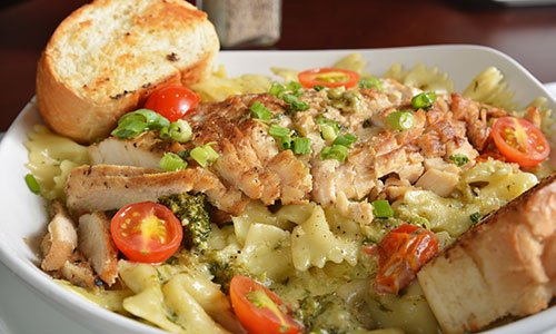 Cajun chicken on bowtie pasta