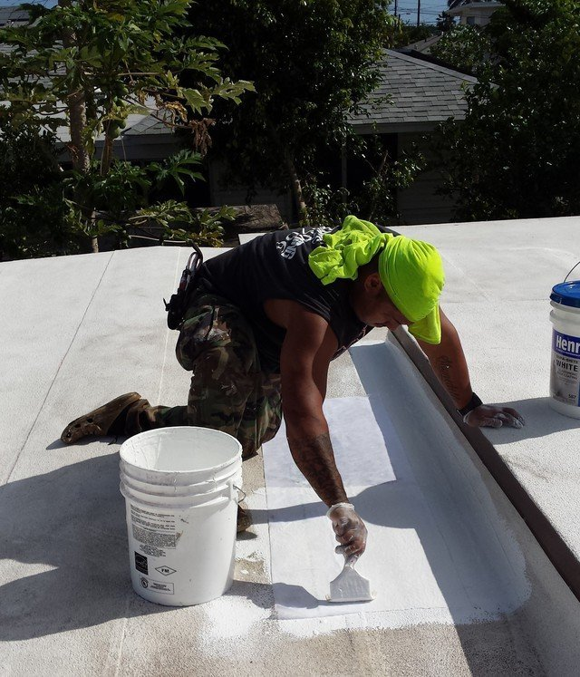 Professional roofer at work site