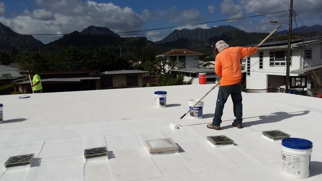 Professional roofer at work location