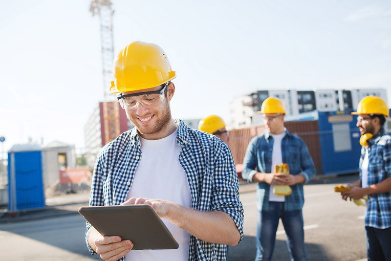 Builder checking safety list of site
